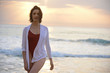 beautiful woman portrait in fashion swimsuit at sunset on the sea