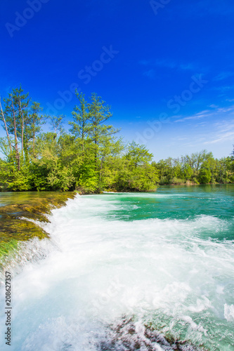 Fotobehang Donkerblauw Beautiful countryside landscape and waterfall in village of Belavici on Mreznica river in Croatia