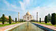 Leinwanddruck Bild - Taj Mahal front view reflected on the reflection pool, an ivory-white marble mausoleum on the south bank of the Yamuna river in Agra, Uttar Pradesh, India. One of the seven wonders of the world.