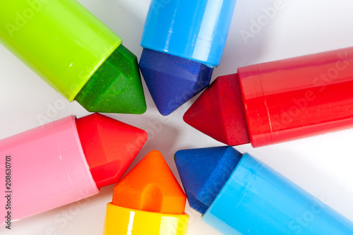 Foto Murales Chunky colorful markers touching eachother making star shape closeup