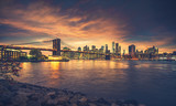 New York City at sunset. NYC famous postcard place at Brooklyn Bridge park with Brooklyn Bridge in front of image. - 208633136