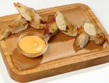 Crispy rolls with chicken, sauce, on wooden Board - 208642196