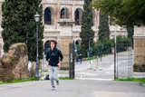 Handsome young sportsman jogging in park in Rome city - 208644751