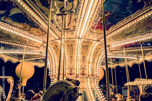 Fotobehang Amusementspark Children's Carousel at an amusement park in the evening and night illumination.