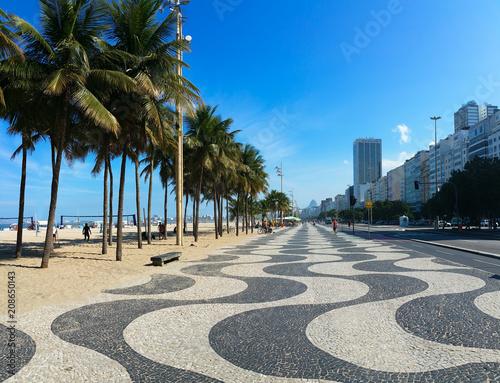 Plexiglas Rio de Janeiro Famous Copacabana Mosaic Sidewalk With Palm Trees in the Beach, in Rio de Janeiro, Brazil