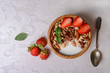 Healthy breakfast  with muesli,  berries and nuts  in bowl on grey background. Healthy food concept. Flat lay.