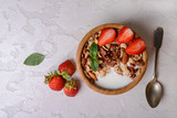 Healthy breakfast  with muesli,  berries and nuts  in bowl on grey background. Healthy food concept. Flat lay. - 208652368