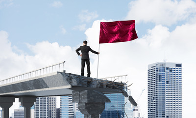 Man with flag presenting leadership concept.