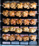 Process of grilling chicken in store - 208659748