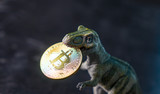 dinosaur keeps in her mouth crypto currency - 208664504