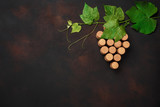 Grape bunch of cork with leaves on rusty background - 208666315