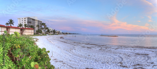 Lowdermilk Beach sunset over powder white sand - 208675504