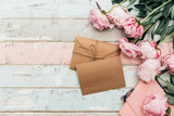 craft envelope and greeting card with peony on wooden background - 208676713