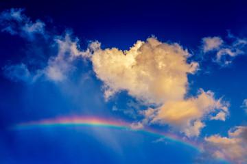Cloud look like dog walk on the rainbow with bright blue sky, sun shine day