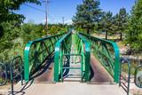 Green Walking Bridge Over Small Creek - 208682932