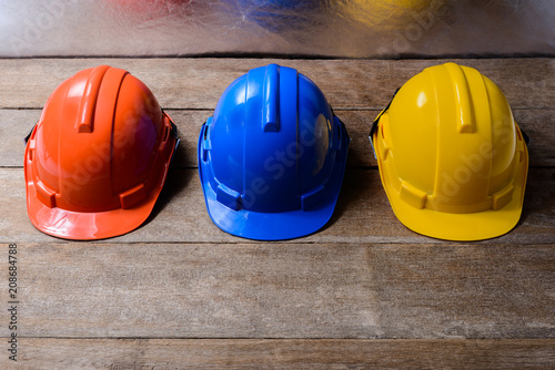 Yellow, Orange and Blue protective safety helmet