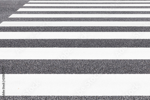 Close - up Zebra crossing pattern on city road - 208699156