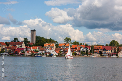 cityscape of Mikolajki with sailing boats on Mikolajskie Lake
