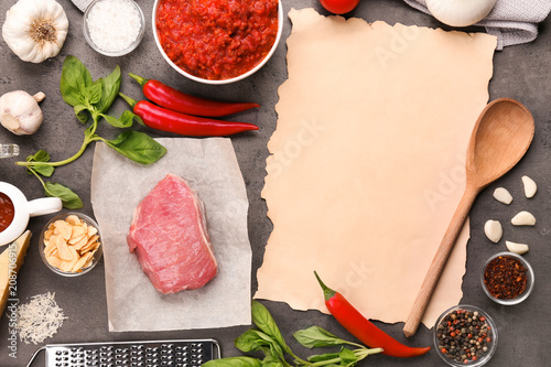 Aluminium Kruiden 2 Composition of raw meat with vegetables and paper on grey background