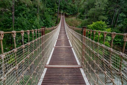 Fototapeta Suspension bridge in Turkey with wood walkway,Adana,Karaisali