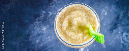 Top view. Green smoothie with celery, banana and apple