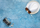 summer vacation, blue background in the form of the sea, hat, shells - 208709572