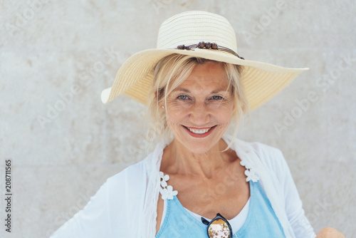 Charismatic blond woman in a trendy straw hat