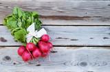 Fresh bunch of radish on  wooden table - 208715958