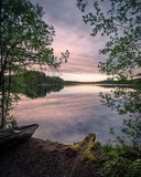 Scenic landscape with idyllic lake view and boat at summer evening in Finland - 208718919