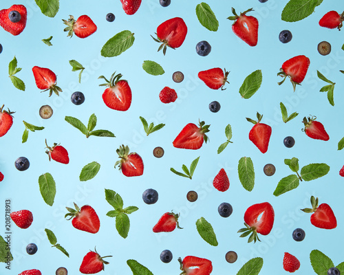 pattern of fresh berries isolated on blue background - 208718913