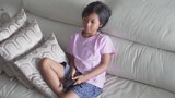 JAKARTA, Indonesia - June 06, 2018: Cute little girl watching TV alone while sitting on the cozy sofa in the living room at home. Shot in 4k resolution - 208719376