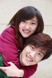 young couple smile at camera - 208727945