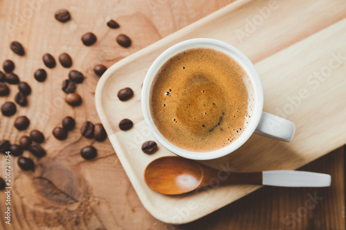 Top view of a espresso coffee cup with a wooden spoon