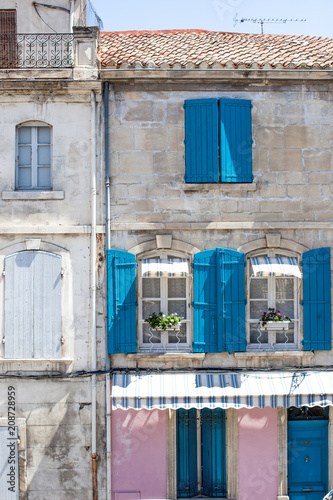 Pretty window facade  with flowers in Arles, Provence, France - 208728959