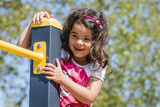 Girl on Playground, climbing, sunny Day, Berlin - 208729519