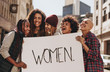 Activists enjoying during a protest for women - 208747116