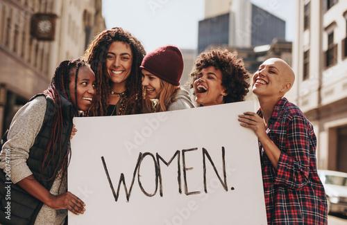 Fototapeta Activists enjoying during a protest for women