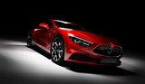 Modern red sports car in a spotlight on a black background. - 208747516
