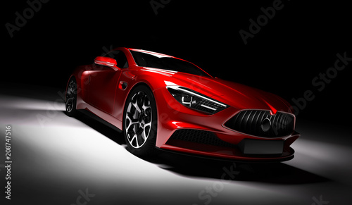 Modern red sports car in a spotlight on a black background.