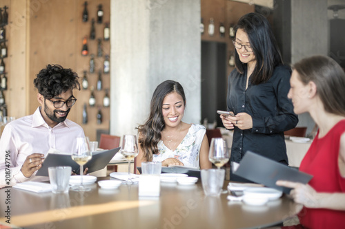 People having a business lunch in an elegant restaurant