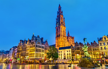 The Cathedral of Our Lady and the Silvius Brabo Fountain on the Grote Markt Square in Antwerp, Belgium