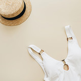 Summer travel fashion composition. Women's swimsuit, straw on pastel beige background. Flat lay, top view minimal clothes concept. - 208754956