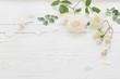 Leinwanddruck Bild - roses on white wooden background