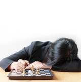 Business woman face down on the table losing in game with chess board for business challenge metaphor and lose compitition concept on the white background with copy space
