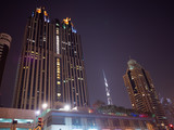 Night view of Dubai Downtown with skyscrapers.