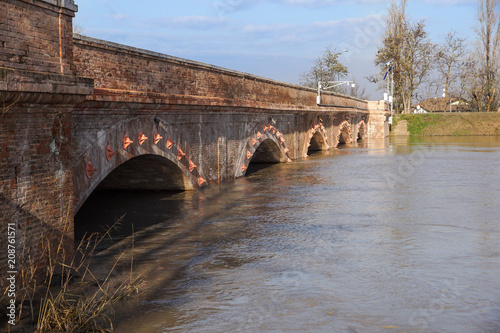 Foto Murales bridge with full river . River is full . Bridge to cross the river that is flooding.
