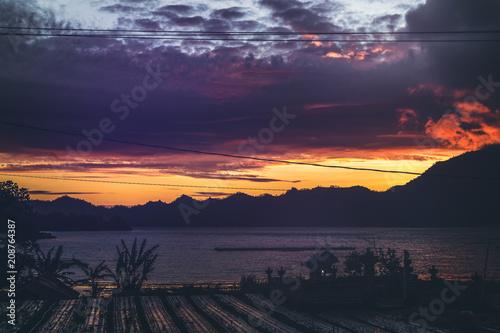 Aluminium Aubergine The sunrise over a lake and mountains. The place is close to volcano Batur, Bali island.