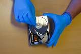 Computer engineer fixing a hard drive to recover data - 208767933