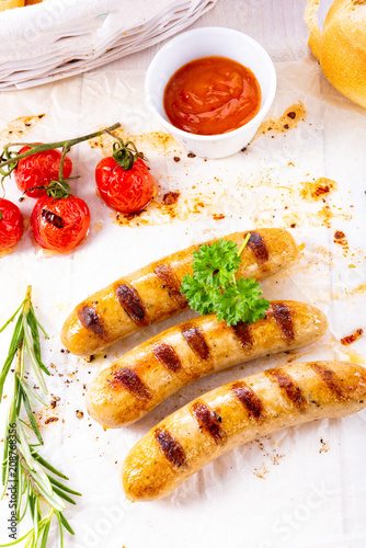 delicious bratwurst with ketchup and fresh rolls - 208768356
