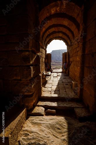 Fotobehang Bruin View through Entrance in Petra in Jordan